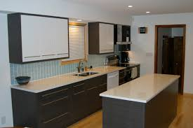 black wooden cabinet and kitchen island with white counter top
