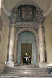bronze door to apostolic palace with swiss guard st peters