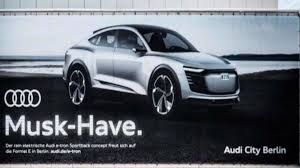 audi trolls tesla with e tron sportback billboard the drive