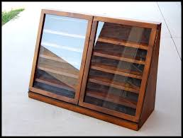 shadow box with shelves and glass door display case cabinet 41 w 29 h 14 d at base 3 d at top interior