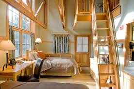 spiffy guest loft bedroom design with wooden stairs as well as
