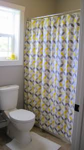 cute shower curtain ideas with fancy yellow and gray motif design