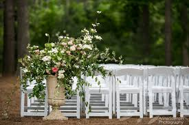 asymmetrical wedding ceremony floral arrangement amy osaba