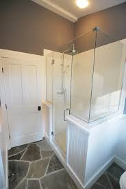 wainscoting and frameless glass shower enclosure not fond of the