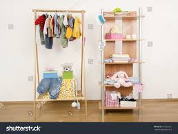 dressing closet complementary clothes arranged on stock photo