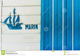 sailboat or fishing boat made of wood as nautical decoration on
