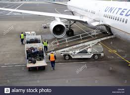 Luggage United Airlines Aircraft Baggage Handlers Load Luggage And Cargo On Virgin