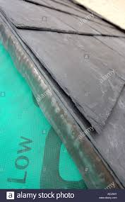 the edge of a slate roof before finishing showing the breathable