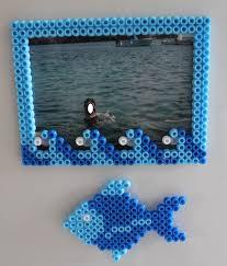 cornici fatte a mano creare cornice magnetica e pesce calamita con perline da stirare
