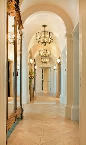 traditional hallway with chandelier by craig tuttle construction