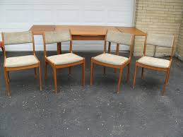 midcenturymodernmania gmail com danish modern teak dining table 4 danish modern teak chairs come with the table above all need to be refinished and they all need new upholstery again teak is easy to refinish