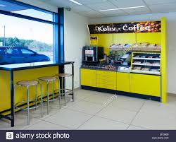 gas station shop with coffee maker shelves and food window seat