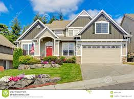 american house with beautiful landscape and vivid flowers stock