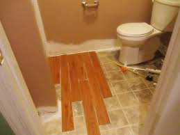 bathroom floor ideas vinyl installing vinyl wood plank flooring in small spaces bathroom