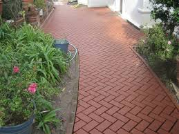 garden brick walkway and white walls plus potted plants for