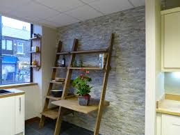 nice brown unfinished wood ladder shelf desk on stone tile kitchen