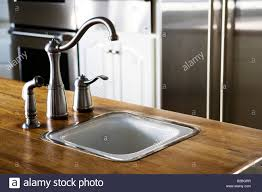 chrome kitchen sink faucet stock photo royalty free image