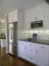 kitchen cabinets microwave shelf microwave shelf dark quartz with white cabinets stainless