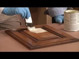 paint vs stain kitchen cabinets steps in painting kitchen cabinets that are stained restoring painting kitchen cabinets