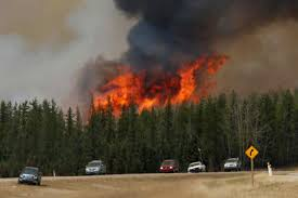 Saskatchewan Wildfire Evacuations by Canada Wildfire Rages Near Oil Sand Facilities Extending Shutdowns