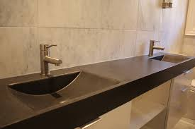 long black bathroom countertop and two shallow sinks of nice