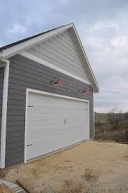 Barn Garage Doors A Carriage Garage Door And Red Barn Lights Newlywoodwards