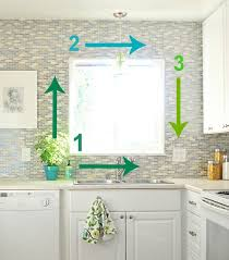how to cut tile around cabinets tiling around a window centsational style