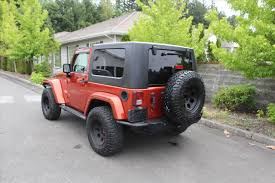 jeep wrangler sunset orange 2009 jeep wrangler sahara in washington for sale used cars on