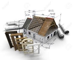 a house under construction with blueprints and a selection of a house under construction with blueprints and a selection of windows and doors stock photo