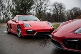 porsche red guards red vs carmine red cayman gts
