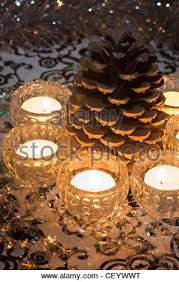 pine cone tea light holder center table with christmas candle and pine cones copy space stock