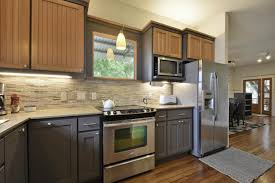 travertine countertops two toned kitchen cabinets lighting