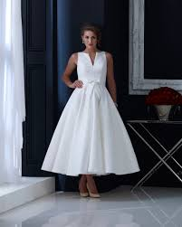 hn veronica brocade tea length wedding dress with subtle bow and