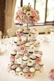 cupcake tower at each table instead of one big cake instead of