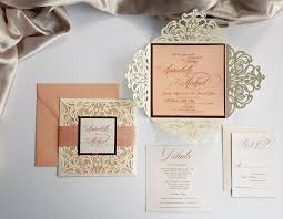 peach laser cut wedding invitations customized with ribbon and