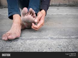 Floor Hand by Dirty Foot Of A Man Sitting On Old Concrete Floor Hand Of A Man