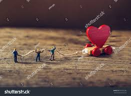 miniature worker try tow red heart stock photo 557957236