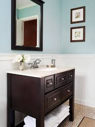 light blue paint in bathroom with dark wood and light counters