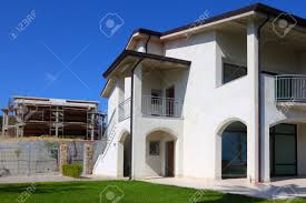 new finished white two story house with garden balcony and stairs