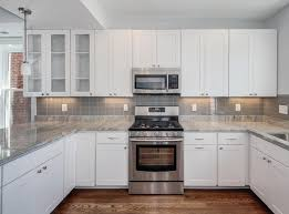 home design backsplash ideas with white cabinets tv above