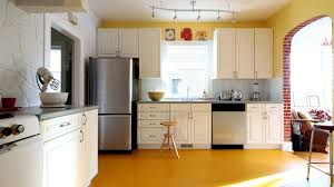 white teak wood kitchen cabinets for yellow interior color