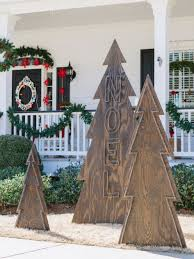 decorations alternative christmas trees features exterior backlit alternative christmas trees features rustic nail head christmas trees wooden fences wreath porch pine garlands grass