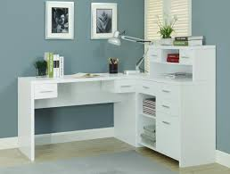 white wooden corner desk with hutch and drawers in blue room of