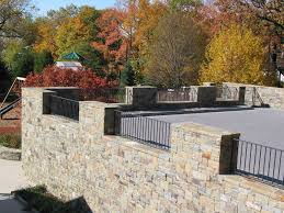 unusual retaining wall ideas with big pebbles and stone pathway