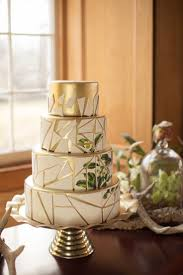 a very modern wedding cake composed of marble geometric rose gold