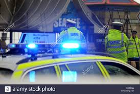 blue light on car the blue light on top of a a police car flashing at the scene of a