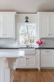 kitchen sink with backsplash farmhouse sink with overhead pendant light by rafterhouse