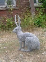 sculpture sitting hare metal wire mesh outside garden yard