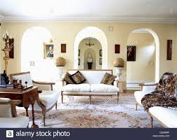 leopard print cushions and throw on white french style sofas in