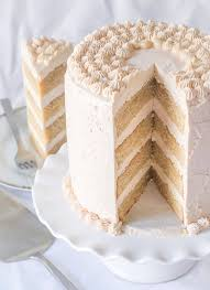 cinnamon layer cake with strawberry rhubarb swiss meringue